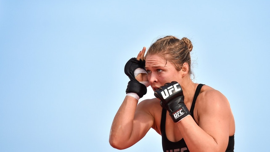 RIO DE JANEIRO, BRAZIL - JULY 29:  Womens bantamweight champion Ronda Rousey of the United States holds an open training session at Pepe Beach on July 29, 2015 in Rio de Janeiro, Brazil.  (Photo by Buda Mendes/Zuffa LLC/Zuffa LLC via Getty Images)