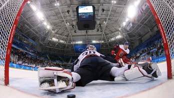 Petr Koukal (42), of the Czech Republic, scores a goal past goalie Ryan Zapolski (30), of the United States, in the penalty shootout duirng the quarterfinal round of the men's hockey game at the 2018 Winter Olympics in Gangneung, South Korea, Wednesday, Feb. 21, 2018. (Ronald Martinez/Pool Photo via AP)