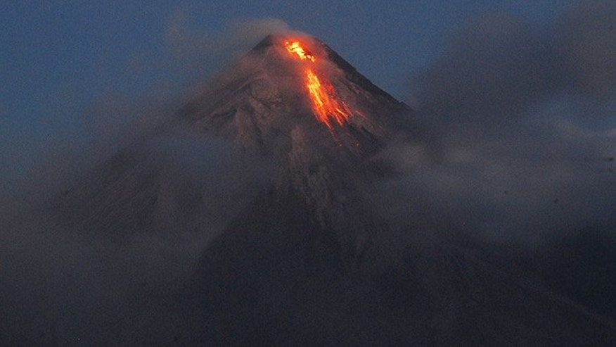 Dec. 15: Lava cascades down the slopes of Mayon volcano in Legazpi city, Philippines. (AP)