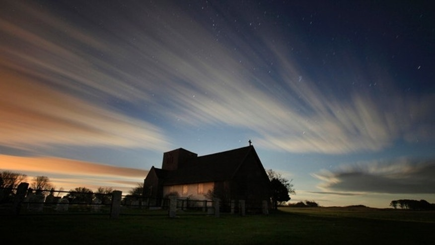 In this two-minute exposure, the rising moon illuminates clouds sweeping across the evening sky over St. Martin's In The Field, an Episcopal summer chapel in Biddeford Pool, Maine. With the winter solstice, Maine now receives only about nine hours of daylight.