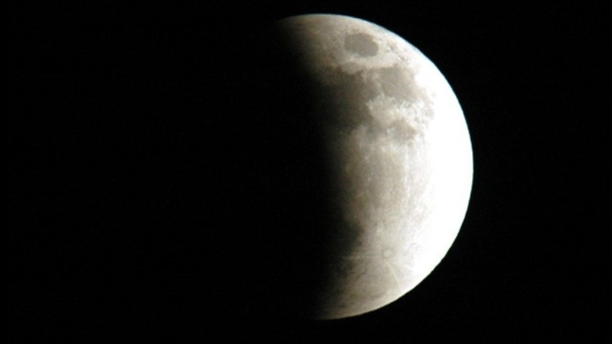The start of a lunar eclipse viewed from Merritt Island, Fla., in 2003. Eclipses occur when the Sun, Earth and Moon line up. They are rare because the Moon usually passes above or below the imaginary line connecting Earth and the Sun.