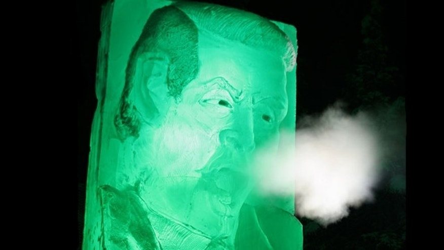 "Blowing smoke (from the tailpipe of a nearby truck), a ""Frozen Gore"" sculpture parodies the former Vice President in Fairbanks, Alaska -- ice sculpture capital of the U.S."