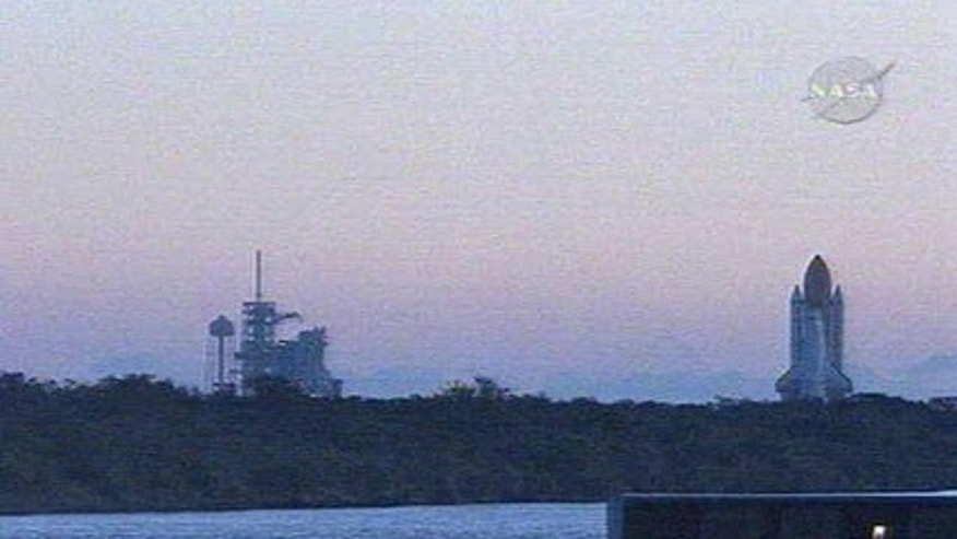 Space shuttle Endeavour rolls out to Launch Pad 39A early Wednesday morning.