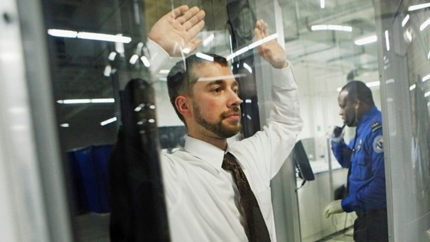FILE - In this Dec. 30, 2009 file photo, Tanner Suttles, left, a Transportation Security Administration employee is screened by a TSA officer during a demonstration of passenger screening technology at the TSA Systems Integration Facility in Arlington, Va. Security experts have floated several new ideas to enhance airport security in the weeks since authorities say a Nigerian man on a Detroit-bound jetliner tried to ignite explosives hidden in his crotch. Some ideas are being tested, others are far from proven, some aren't being seriously considered. Many raise questions about civil liberties and all are costly. (AP Photo/Haraz N. Ghanbari)