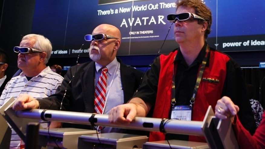 Attendees watch the movie Avatar in 3D at the Panasonic exhibit at the Consumer Electronics Show in Las Vegas.