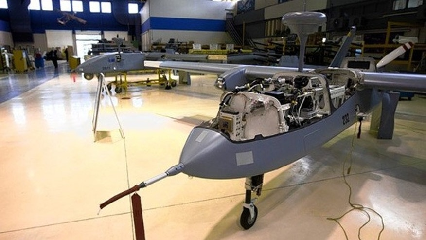 Israel pioneered the use of aerial drones like the Heron, under construction, above, at Israeli Aerospace Industries. (David Furst/AFP for The Wall Street Journal)
