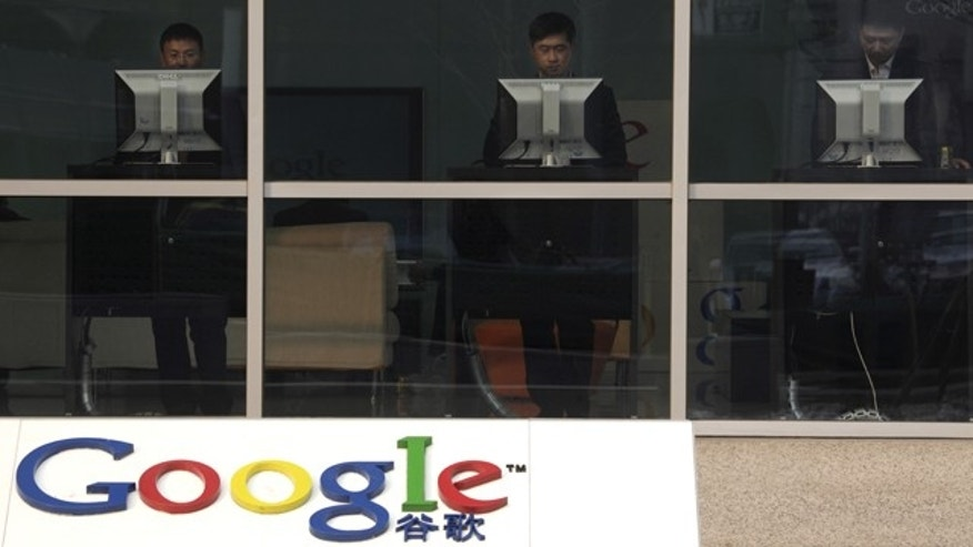 Computer users at the reception area of Google's China headquarters in Beijing.
