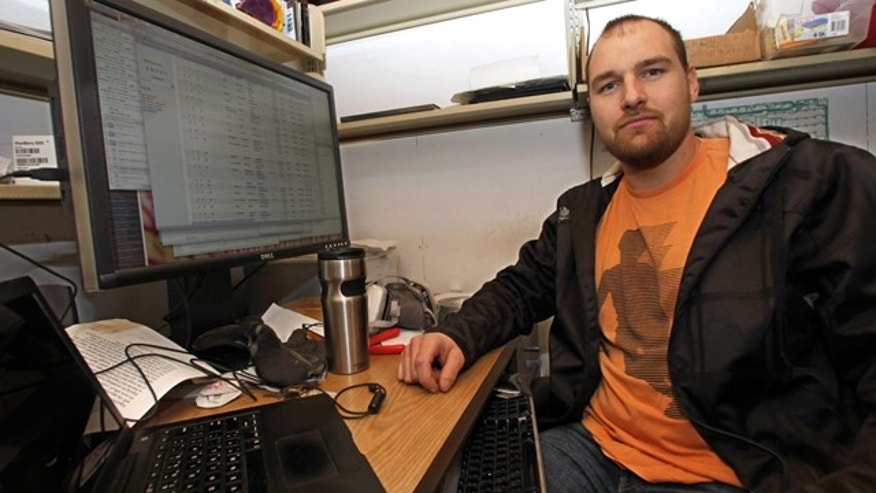 Tim Schwartz, a 28-year-old artist and programmer, sits in his studio at the University of California-San Diego, where he developed a database for persons missing in the Haiti earthquake.