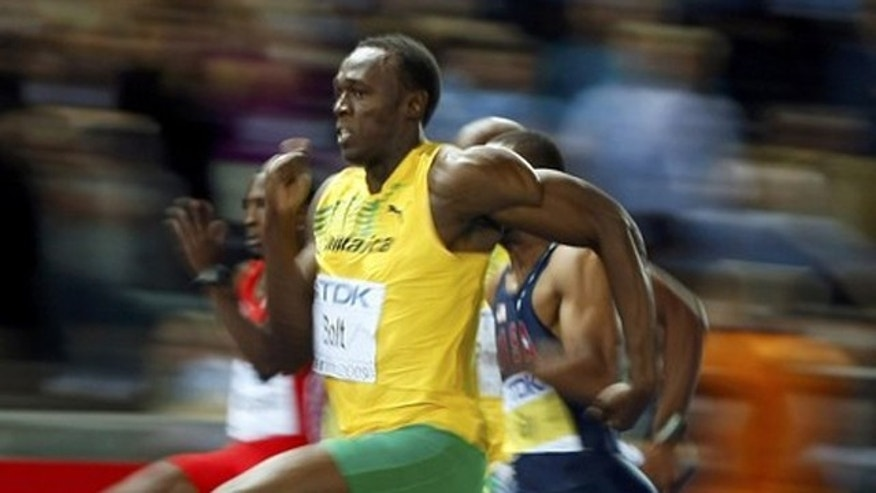 Usain Bolt of Jamaica sprints to the finish to win in the men's 100 meters final during the world athletics championships at the Olympic stadium in Berlin.