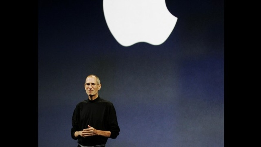 FILE - In this Sept. 9, 2009 file photo, Apple CEO Steve Jobs is seen during an Apple event in San Francisco. Apple&#39&#x3b;s new touch-screen &quot&#x3b;tablet&quot&#x3b; computer, expected to be unveiled Wednesday, Jan. 27, 2010, could give publishers the alternative to Amazon.com they have been craving and give consumers a new way to think about reading books without paper. (AP Photo/Paul Sakuma, File)