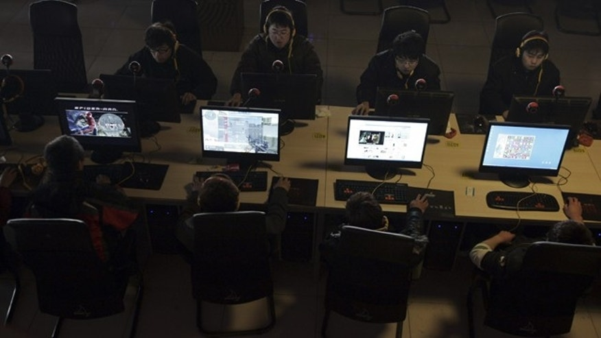 People use computers at an Internet cafe in Taiyuan, in north China's Shanxi province, Monday Jan. 25, 2010.