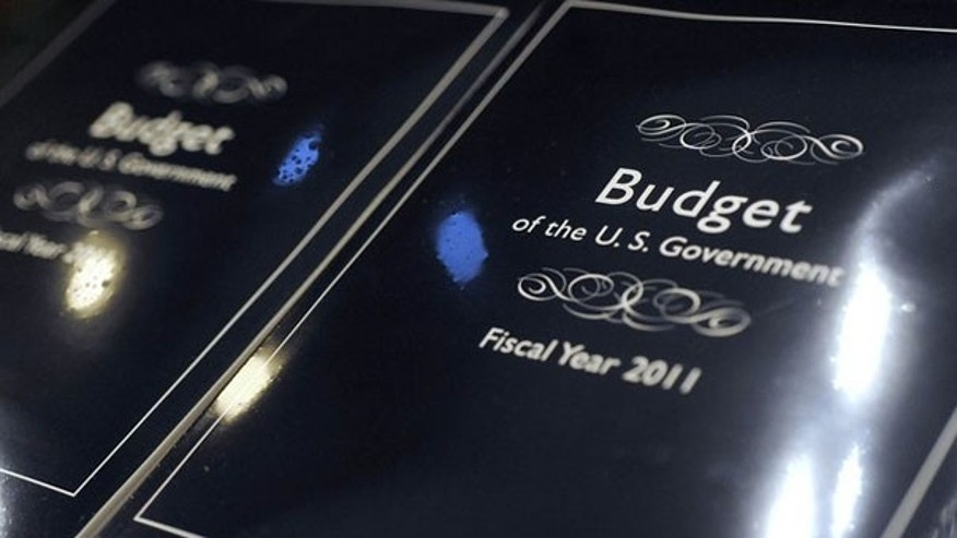 The cover of President Obama's 2011 budget is seen as copies are unpacked for distribution to Senate staff on Capitol Hill Feb. 1.