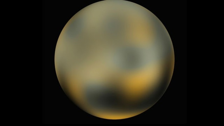 This undated handout photo provided by NASA, taken by NASA's Hubble Space Telescope, shows the dwarf planet Pluto.