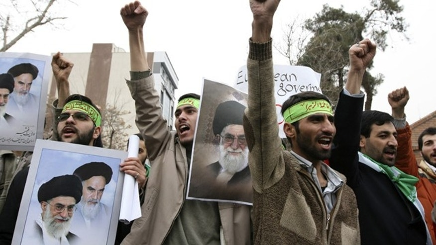 Iranian protesters shout slogans during a demonstration in Tehran February 9, 2010.