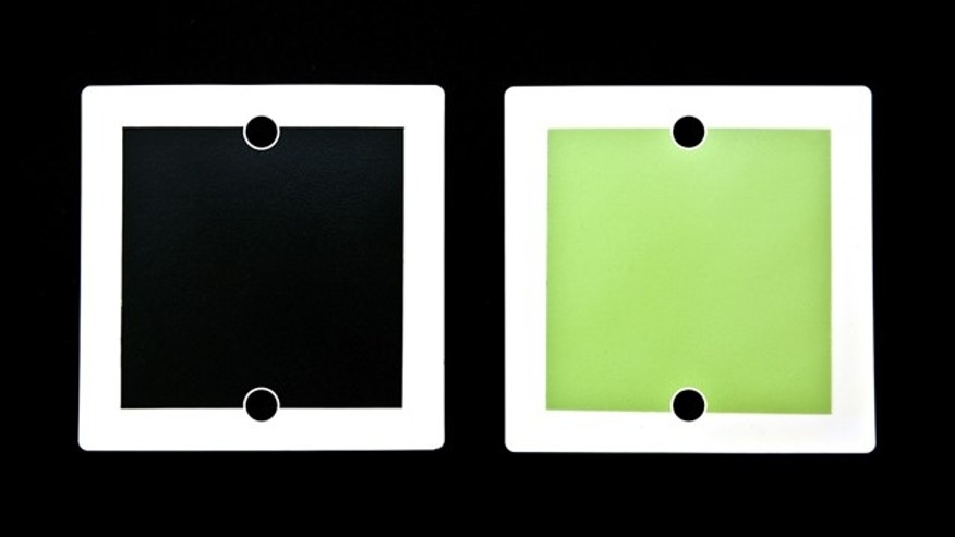 "Bloom Energy's fuel cells are flat, solid ceramic squares made from a common sand-like ""powder"" and are painted with patented inks to create anode (green) and cathode (black) sides. Each fuel cell represents 25 watts of power or enough for one lightbulb."