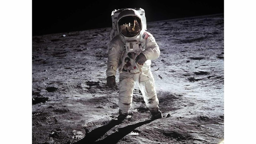 Buzz Aldrin on the moon. Aldrin's helmet visor shows a reflection of astronaut Neil Armstrong taking this picture.
