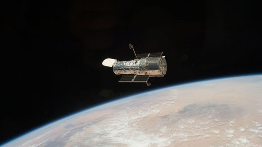 The Hubble Space Telescope, seen here in orbit above the Earth, after it was released from the shuttle Atlantis at the close of the STS-125 servicing mission in May 2009.