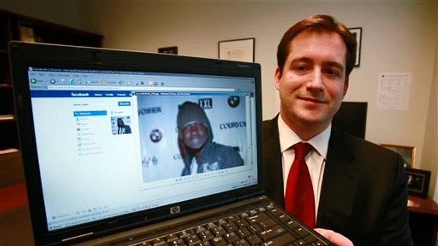 October 13, 2009: Assistant U.S. Attorney Michael Scoville displays part of the Facebook page, and an enlarged profile photo, of fugitive Maxi Sopo in Seattle. The Feds are on Facebook. And MySpace, LinkedIn and Twitter, too.