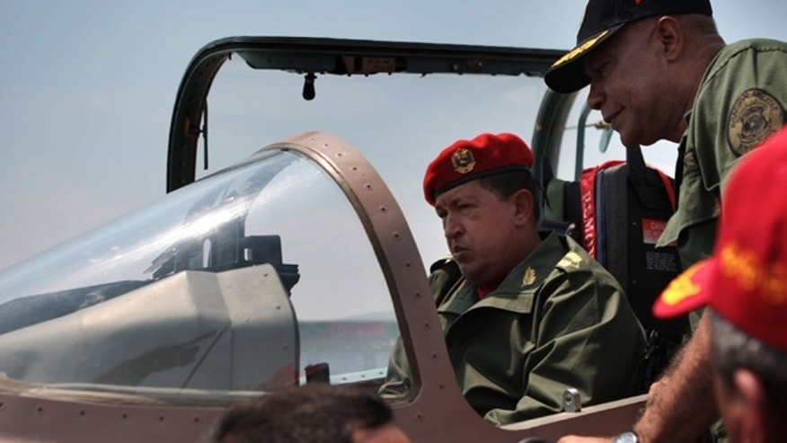 Venezuela's President Hugo Chavez checks a Chinese-made military plane during a ceremony at a military base.