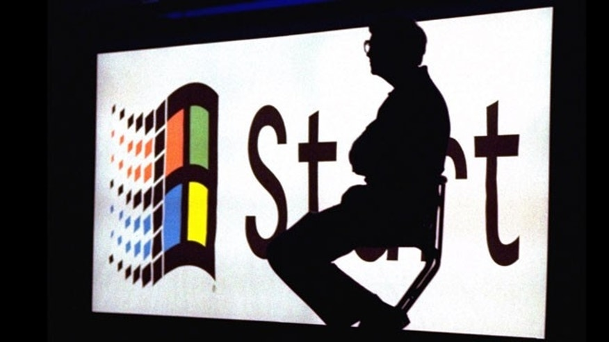 Microsoft Chairman Bill Gates sitting on stage during a video portion of the Windows 95 Launch Event, on the company's campus in Redmond, Washington.
