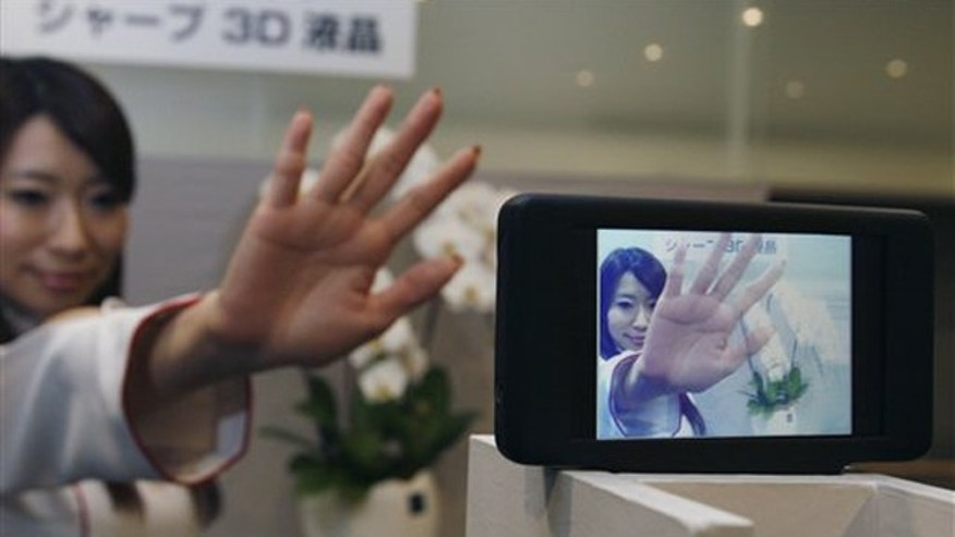 A model's image is shown in the 3D liquid crystal display which is unveiled to the media by Sharp Corp. in Tokyo, Japan, Friday, April 2, 2010. Sharp's latest 3D displays deliver bright, clear imagery without the cumbersome glasses usually required for such technology. Sharp Corp. demonstrated liquid crystal screens Friday for mobile devices that showed 3D animation, touch-panel screens that switched from one 3D photo to another and a display connected to a 3D video camera.