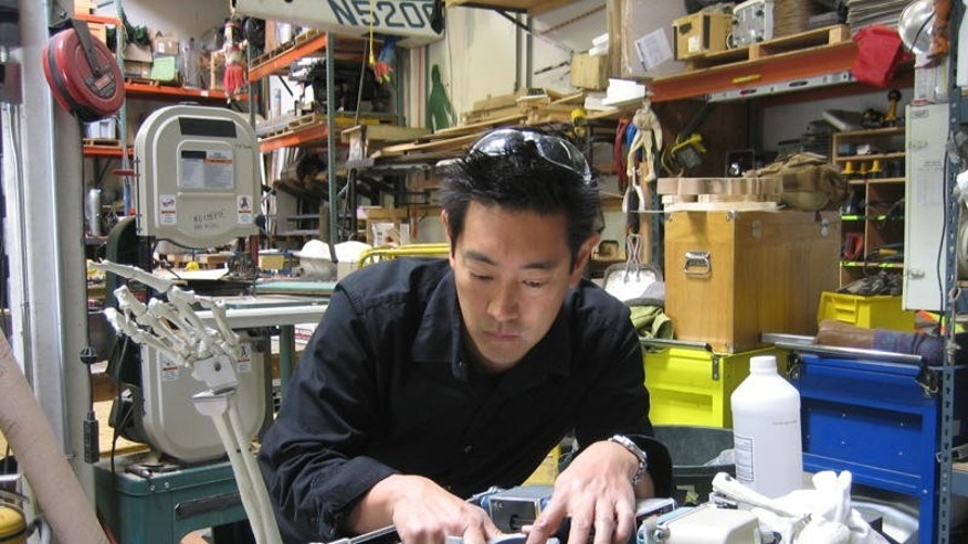 "Grant Imahara, co-host of Discovery Channel's ""MythBusters"" program, puts the finishing touches on a robot skeleton sidekick for Craig Ferguson."