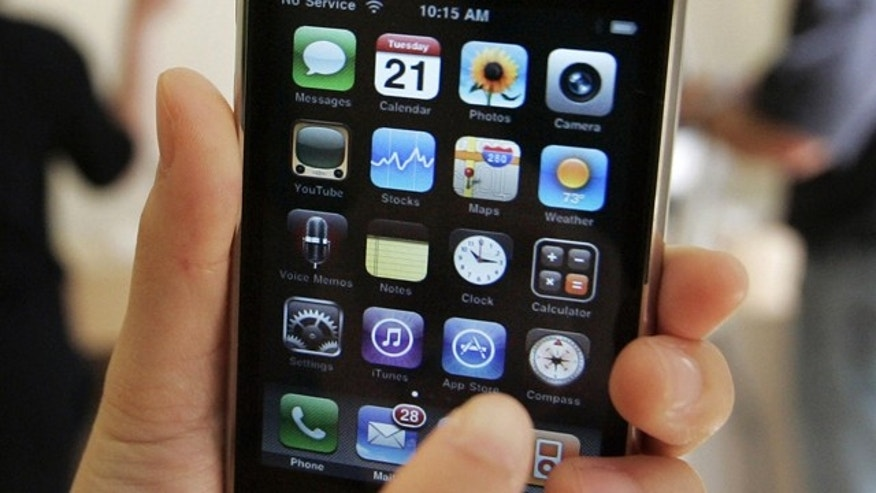 FILE - In this July 21, 2009 file photo, a customer displays an Apple iPhone 3GS at an Apple store in Palo Alto, Calif. Apple Inc. shares have hit another all-time high Tuesday, March 30, 2010, now that it appears the iPhone could find a new sales outlet through Verizon Wireless. (AP Photo/Paul Sakuma, File)