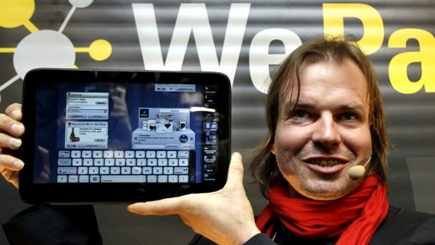 Helmut Hoffer von Ankershoffen, Managing Director of the Neofonie company poses with the new 'WePad' tablet PC during a news conference in Berlin, Germany, Monday  April 12, 2010. The German maker of a new tablet computer is setting out to rival Apple's iPad with the promise of even more sophisticated technology.