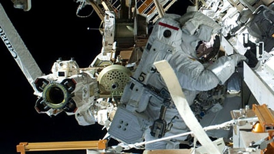 Mastracchio and Anderson complete the installation of an ammonia tank during the final spacewalk, which began at 2:14 a.m.