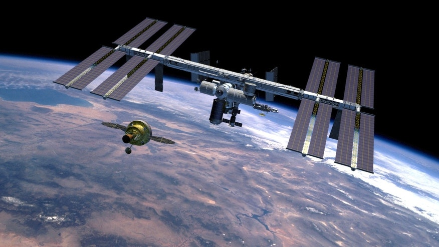 The Orion spacecraft, intended to return humans to the moon and prepare for future voyages to Mars and other destinations in our solar system. This artist's rendering represents a concept of the Orion spacecraft approaching the International Space Station in Earth-orbit.
