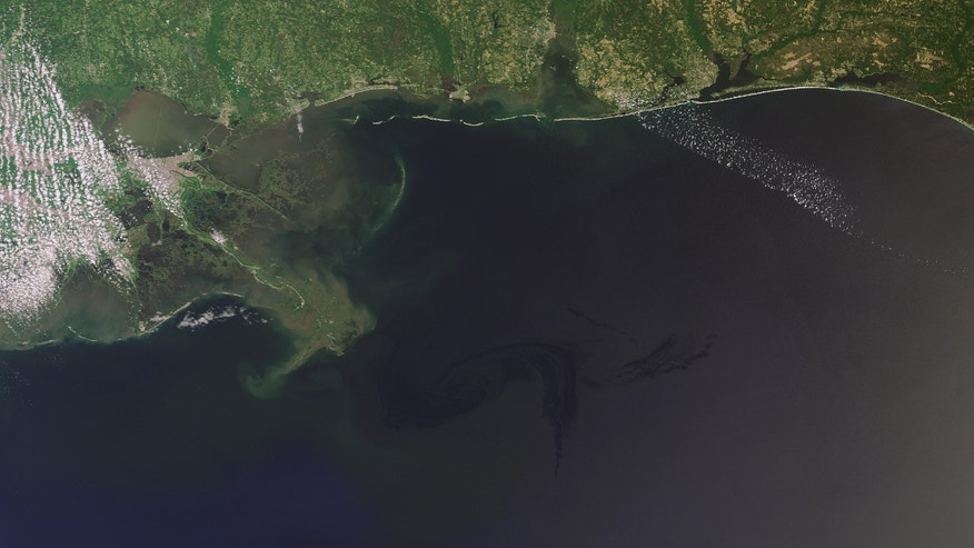 April 29: Oil from the massive spill in the Gulf of Mexico can be seen as a dark blue swirl advancing toward the Louisiana coast.
