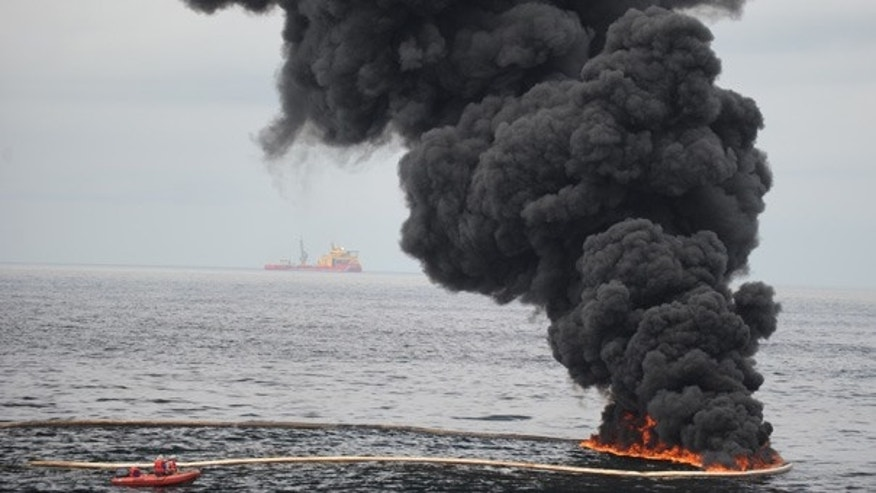 May 5: Gathered, concentrated oil burns during a controlled fire in the Gulf of Mexico.