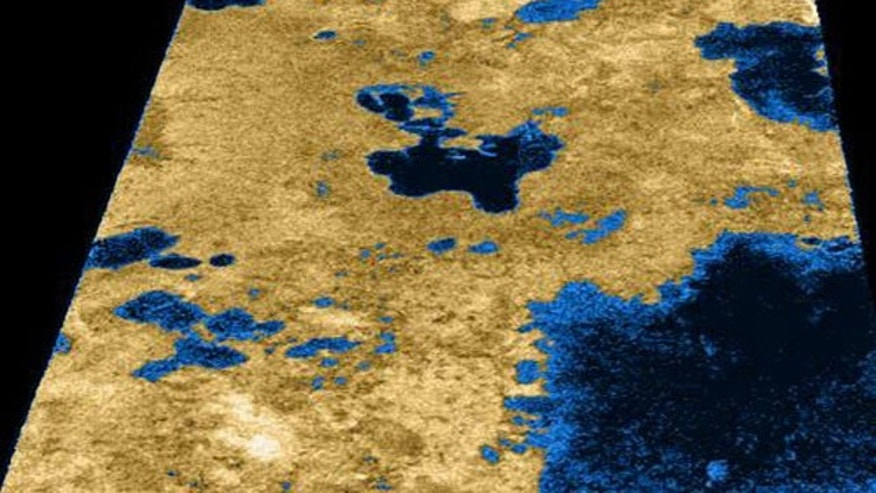 The irregular black shapes in this Cassini radar image of Titan's northern polar region are believed to be liquid methane-ethane lakes.