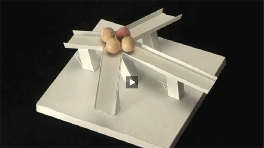 A mind-bending illusion appears to demonstrate wooden ballets magentically climbing a hill -- but it's just an optical illusion. Watch the video below and judge for yourself.