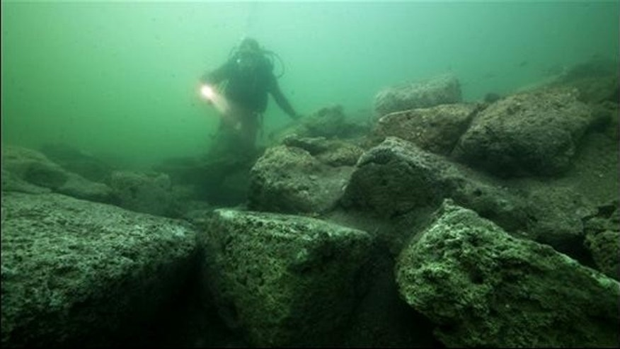 May 25: A diver inspects limestone blocks that form part of the ruins of the Temple of Isis on the royal island of Antirhodos, on the seabed of the harbor of Alexandria, Egypt. They're exploring the submerged ruins of a palace and temple complex from where Queen Cleopatra ruled, painstakingly excavating one of the richest underwater archaeological sites in the world and retrieving stunning artifacts from the last dynasty to rule over ancient Egypt before the Roman Empire annexed it in 30 B.C.