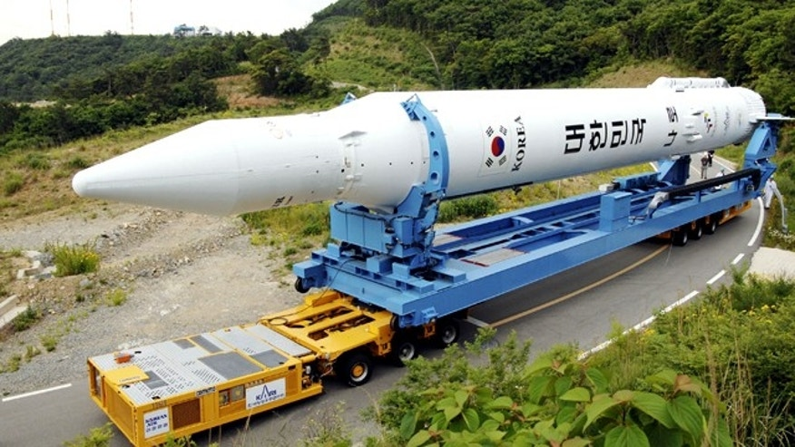 "The Korea Space Launch Vehicle-1, South Korea's second space rocket, is wheeled to a launch pad at the Naro Space Center in Goheung, South Korea, Monday, June 7, 2010. The rocket is scheduled to blast off on June 11. The launch of the first rocket last August failed due to problems in fairing assembly. The Korean characters on the rocket read: ""Republic of Korea."""