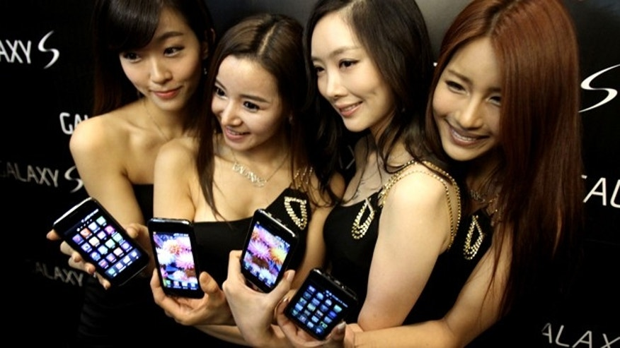 Models display a new Samsung phone running Google's Android operating system -- one of many smart phone platforms vying for consumer attention.