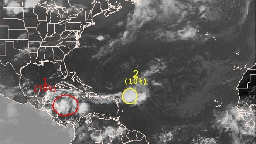 The outlined area in this satellite photo indicate the current position of systems being monitored by the National Hurricane System. Color indicates the probability that the formation will become a tropical cyclone within 48 hours.