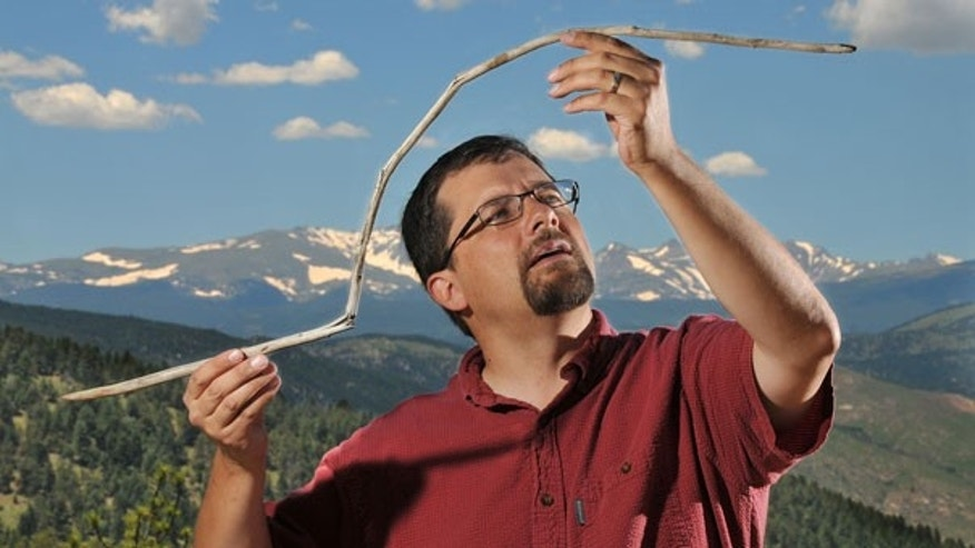 June 28: University of Colorado research associate Craig Lee holds a 10,000-year-old atlatl dart that had been frozen in an ice sheet near Yellowstone National Park. The dart was straight when it was entombed and became bowed from the melting and barely survived being snapped in half by a passing animal.