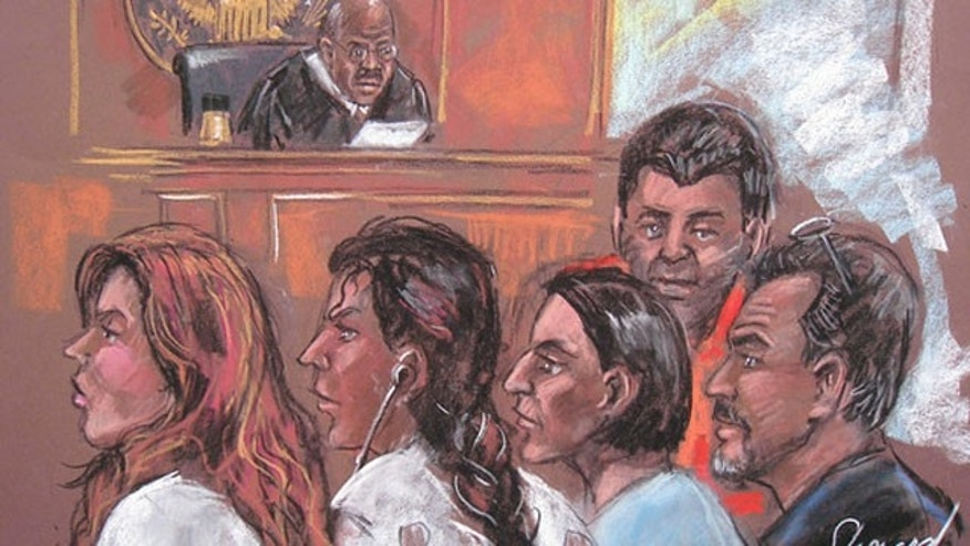 June 28: A court drawing shows five of the 11 alleged spies in a New York court appearance following their arrests (AFP).