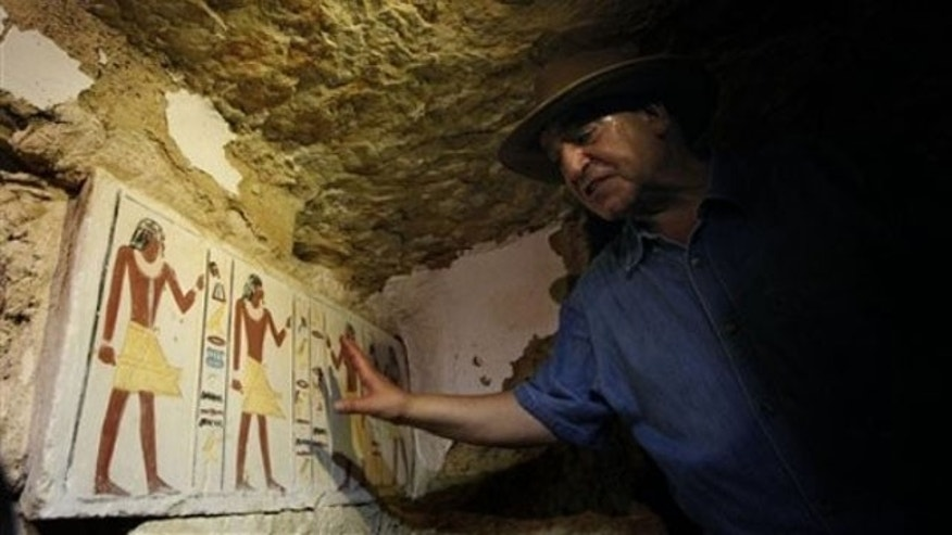 July 8: Egyptian Antiquities chief Zahi Hawass shows a false door to an unearthed 4,300-year-old tomb that belongs to Khonsu, the son of Shendwas. Both served as heads of the royal scribes during the Old Kingdom, in Saqqara near Cairo, Egypt.
