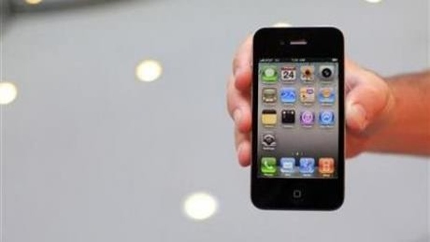 June 24: A customer displays an iPhone 4 purchased at the Apple Store 5th Avenue in New York.