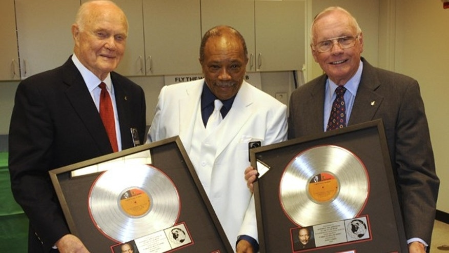 "Grammy Award-winning producer Quincy Jones (center) presented a platinum copy of ""Fly Me to the Moon"" to Senator John Glenn (left) and Apollo 11 Commander Neil Armstrong (right) during NASA's 50th anniversary gala in 2008."