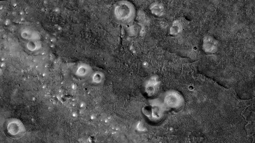 The mud volcanoes shown here, located in the Southern Acidalia Planitia region of Mars, might contain organic materials that could hold signatures of life.