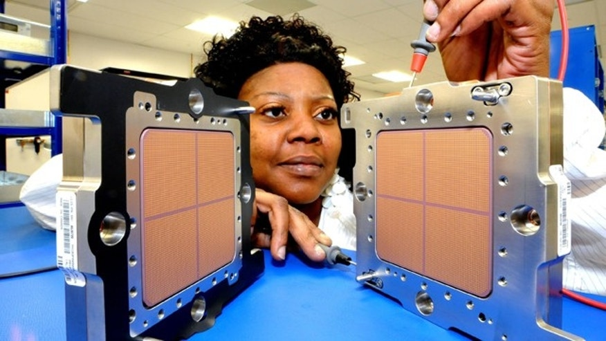 IBM technician Asia Dent tests the world's fastest microprocessor, made in New York and shipping to clients on Sept. 10. The heart of IBM's new zEnterprise System mainframes, the new chip helps deliver world-record speeds of 5.2 GHz.
