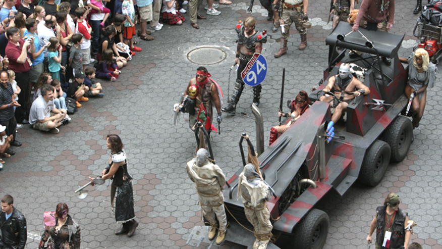 """To the delight of onlookers, a parade based on the film """"Mad Max"""" marches by during the 2009 Dragon Con."""