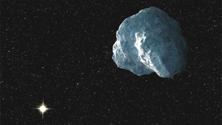 An artist's concept of a craggy piece of Solar System debris that belongs to a class of bodies called trans-Neptunian objects. Astronomers culling the data archives of NASA's Hubble Space Telescope have added 14 new TNOs to the catalog.