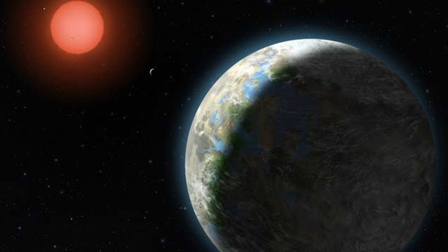 This artist's conception shows the inner four planets of the Gliese 581 system and their host star, a red dwarf star only 20 light years away from Earth. The large planet in the foreground is the newly discovered GJ 581g, which has a 37-day orbit right in the middle of the star's habitable zone and is only three to four times the mass of Earth, with a diameter 1.2 to 1.4 times that of Earth.