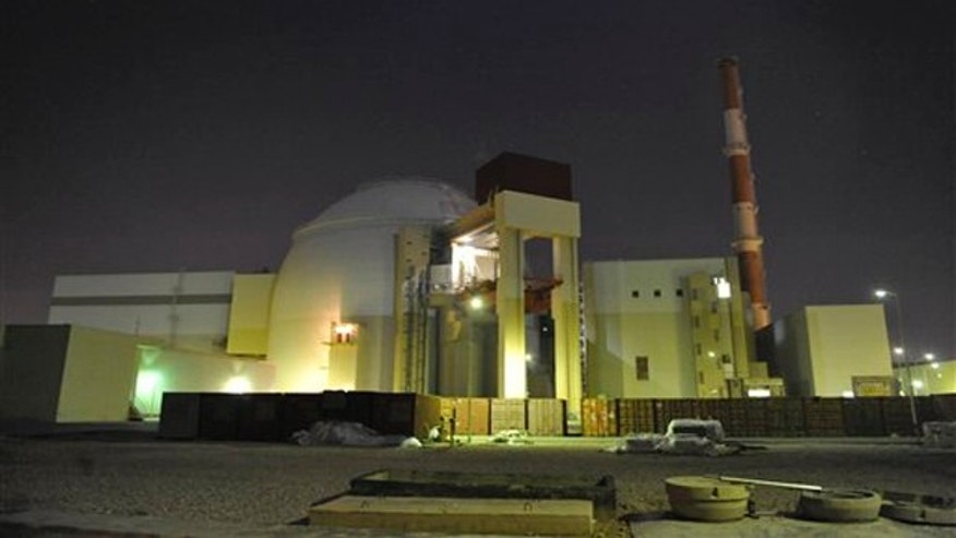 The reactor building of Iran's Bushehr Nuclear Power Plant is silhouetted in this November 2009 photo released by the semi-official Iranian Students News Agency (ISNA).