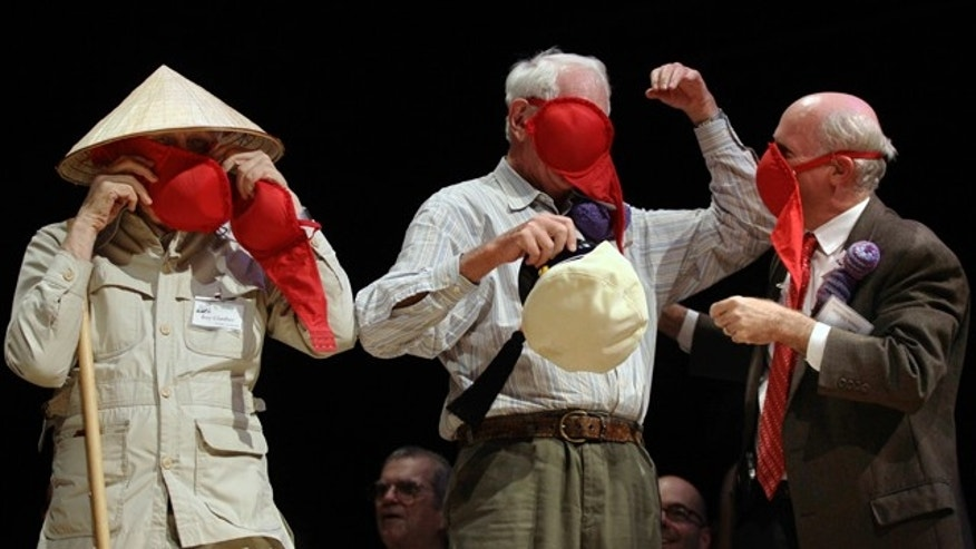 Nobel laureates Roy Glauber (Physics, 2005), left, Sheldon Glashow (Physics, 1979), center, and James Muller (Peace, 1985) demonstrate how women's bras can be used as emergency gas masks during the Ig Nobel Prize ceremony, Thursday, Sept. 30, 2010, at Harvard University in Cambridge, Mass.